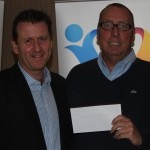 Jack receiving his cheque for the Steve Charles help a friend fund