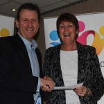Jenny form Westfield Arts College receiving their cheque.